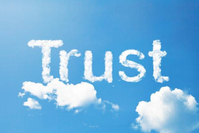 the words trust spelled out in the clouds